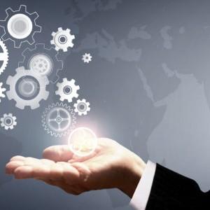 Businessman Holding Virtual Cogwheels - Business and Work